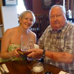 Caroline Pearson receives her trophy from Dave Wedge